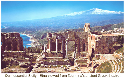 Snow-capped Mount Etna viewed from  Taormina's ancient amphitheatre.
